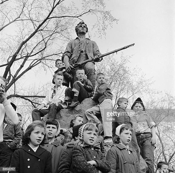 Children watching 'Patriots Day' celebrations on Lexington Green to mark The Battle of Lexington, a brief skirmish that marked the first military...