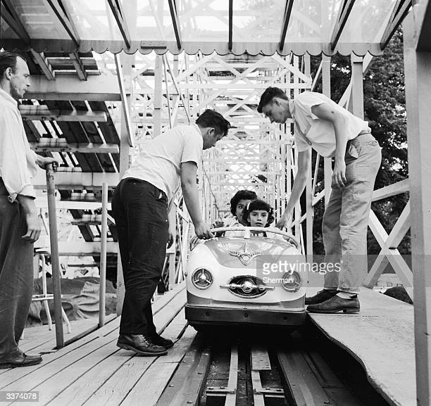 Employees of Palisades Amusement Park New Jersey check the safety devices on each car before sending them on the Wild Mouse Ride