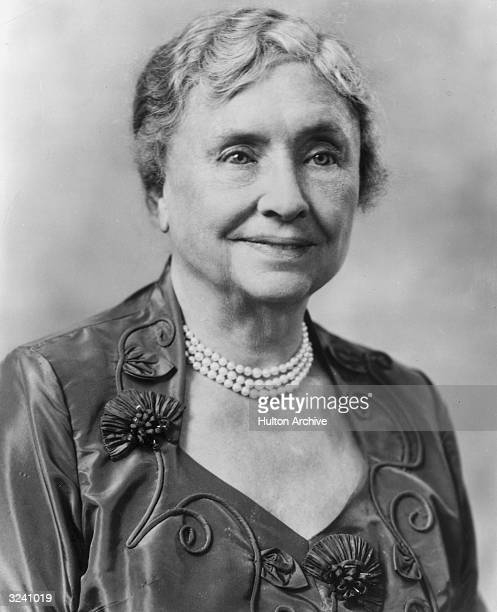 Headshot portrait of American educator and activist for the disabled Helen Keller wearing a pearl necklace and a dress with a semisquare cut neckline...