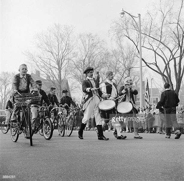 Mock Fife and drum units marching through Lexington Green during 'Patriots Day' celebrations to mark The Battle of Lexington, a brief skirmish that...