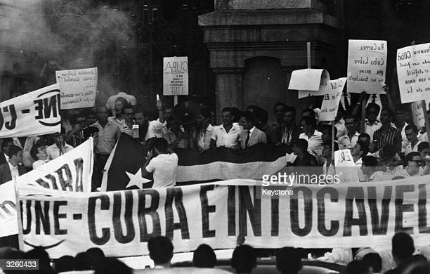 Students and peasants demonstrate in Rio in support of the Cuban revolution The demonstrators carried placards condemning the aggressive threats of...