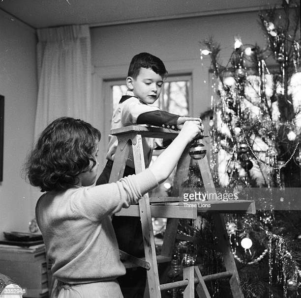 The Christmas decorations go up in home of radio and television announcer Frank Blair