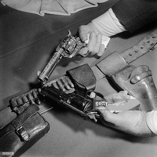 Two guns originally owned by General George Patton are displayed against a cartridge belt The upper is a Colt single action 45 calibre deluxe army...