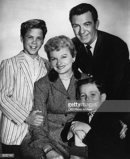 American actors Tony Dow Hugh Beaumont Jerry Mathers and Barbara Billingsley pose together in a promotional portrait for the television series 'Leave...