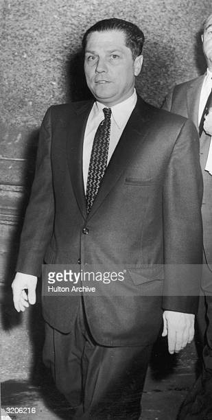 American labor leader Jimmy Hoffa walking in a suit and tie. Hoffa disappeared in 1975, and is believed to have been kidnapped and murdered.