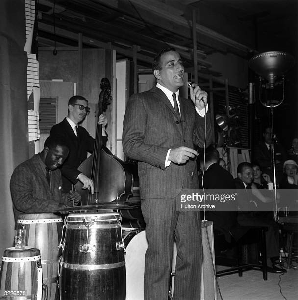 American singer Tony Bennett performs on stage with American jazz drummer Art Blakey