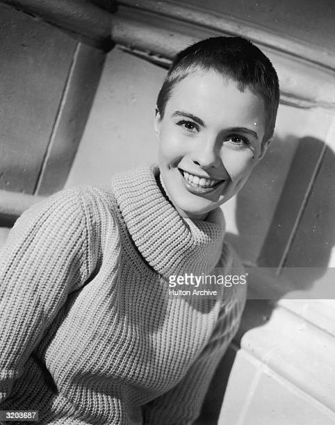 Headshot of American actor Jean Seberg smiling taken during the making of director Otto Preminger's film 'Saint Joan' in which she played Joan of Arc...