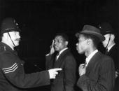 Circa 1958 a confrontation between a policeman and an african man in picture id2659436?s=170x170