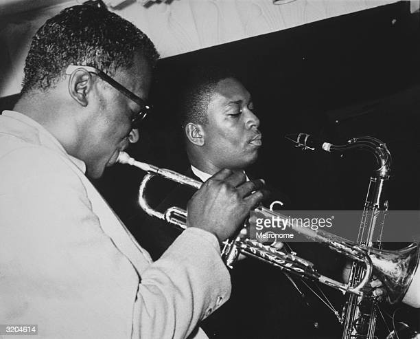 EXCLUSIVE LR American jazz trumpeter Miles Davis performs with tenor saxophonist John Coltrane Coltrane played in Davis' Sextet that year Davis wears...