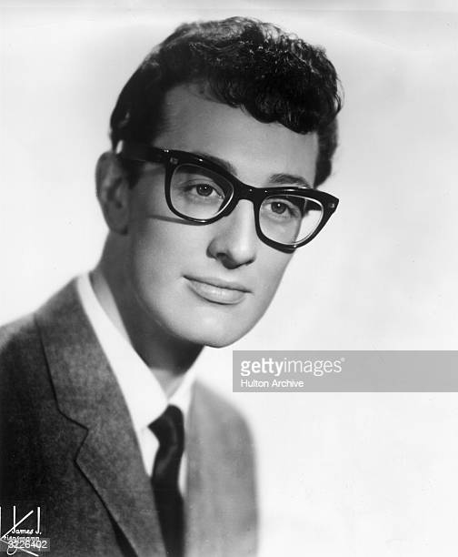 Headshot of American rock 'n' roll musician and singer Buddy Holly wearing his signature hornrimmed eyeglasses