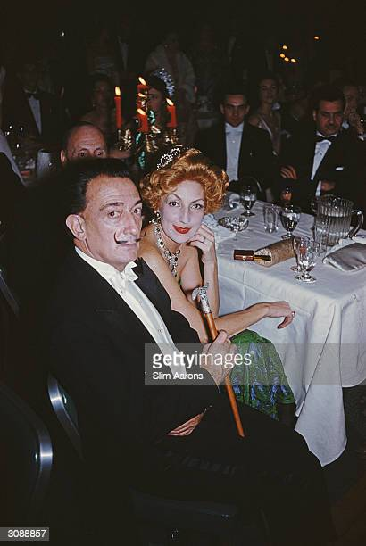 Surrealist painter Salvador Dali with a redhaired woman at a ball in New York A Wonderful Time Slim Aarons