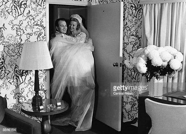 A bride being carried over the threshold after being married