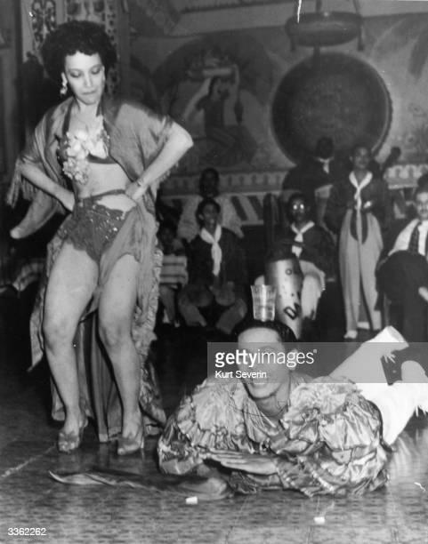A couple dancing the rhumba in a club in Cuba