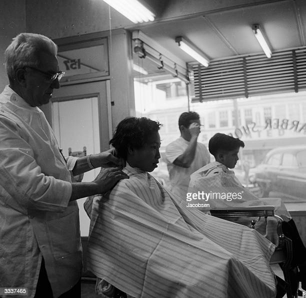 A couple of children at a barber's shop