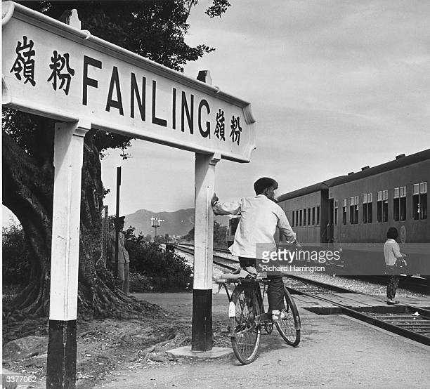 A dieselpowered train passing through Fanling Station in the New Territories Hong Kong on its way to the border with China