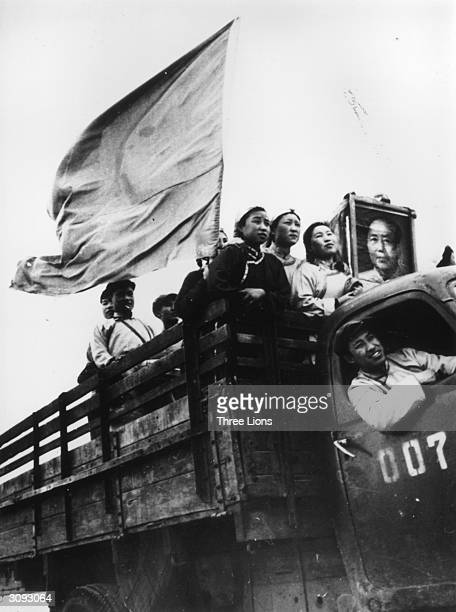 A group of Chinese artists on their way from Huhehot to Inner Mongolia A picture of Mao and a red flag adorn their truck