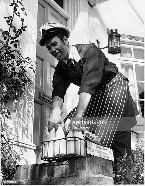 A milkman leaves the daily quota of milk on the doorstep