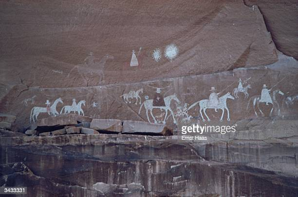 Petroglyph on a wall in the Canyon de Chelly, Arizona. It is considered to document the arrival of the Spaniards with the cross of Christianity and...