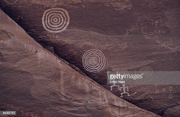 Primitive petroglyph on a wall in the Canyon de Chelly, Arizona. Image Appears - America ! In America book