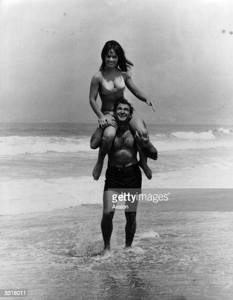 Actor Rod Taylor Giving Dancer Tania Lemani A Piggy Back