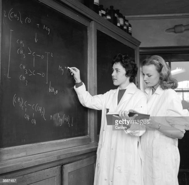 Alice Kandell and Sandra Edelson work on a equation during a chemistry class at Sarah Lawrence College, New York.