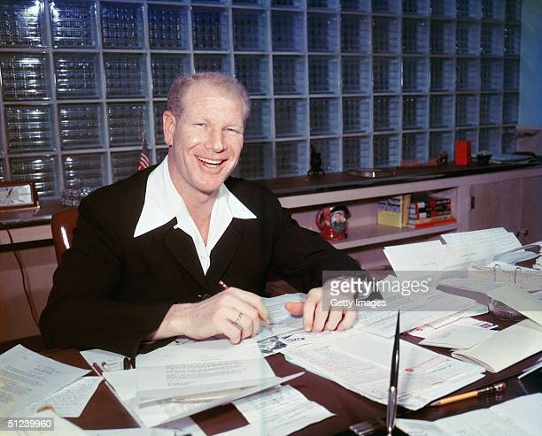 Circa 1960 American baseball executive Bill Veeck owner of the Chicago White Sox sitting at a desk and smiling He was known as the 'P T Barnum of...