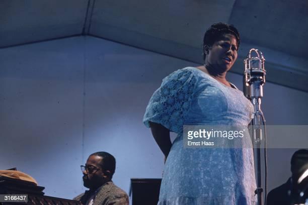 American jazz singer Mahalia Jackson performing at a concert