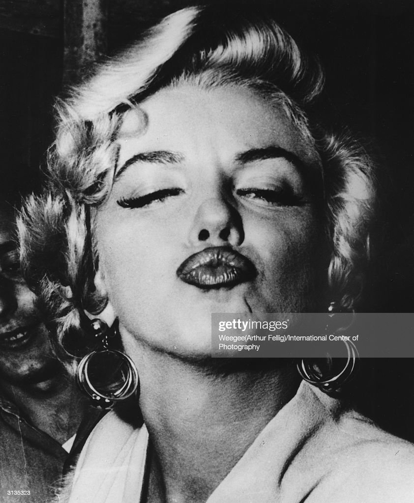 American movie actress and sex symbol Marilyn Monroe (1926 - 1962) blows a pouting kiss. (Photo by Weegee(Arthur Fellig)/International Center of Photography/Getty Images)