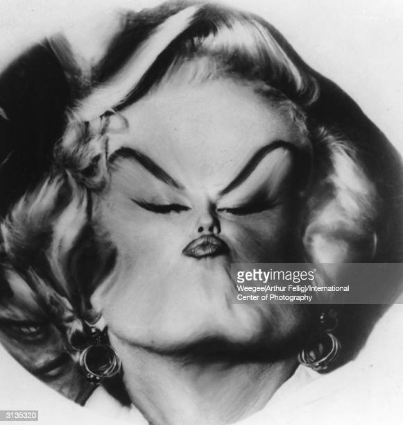 American movie actress and sex symbol Marilyn Monroe with her features sucked into the middle of her face by Weegee's plastic lens Photo by...