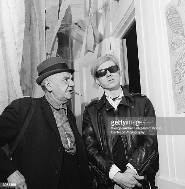 American photographer Arthur 'Weegee' Fellig with pop artist and filmmaker Andy Warhol Photo by Weegee/International Center of Photography/Getty...