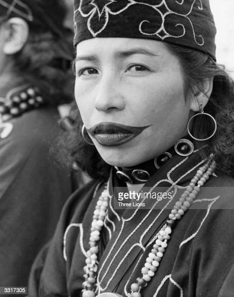 An Ainu woman from northern Japan with tattooed lips The upper lip is slashed during childhood and ashes are rubbed in to leave a scar