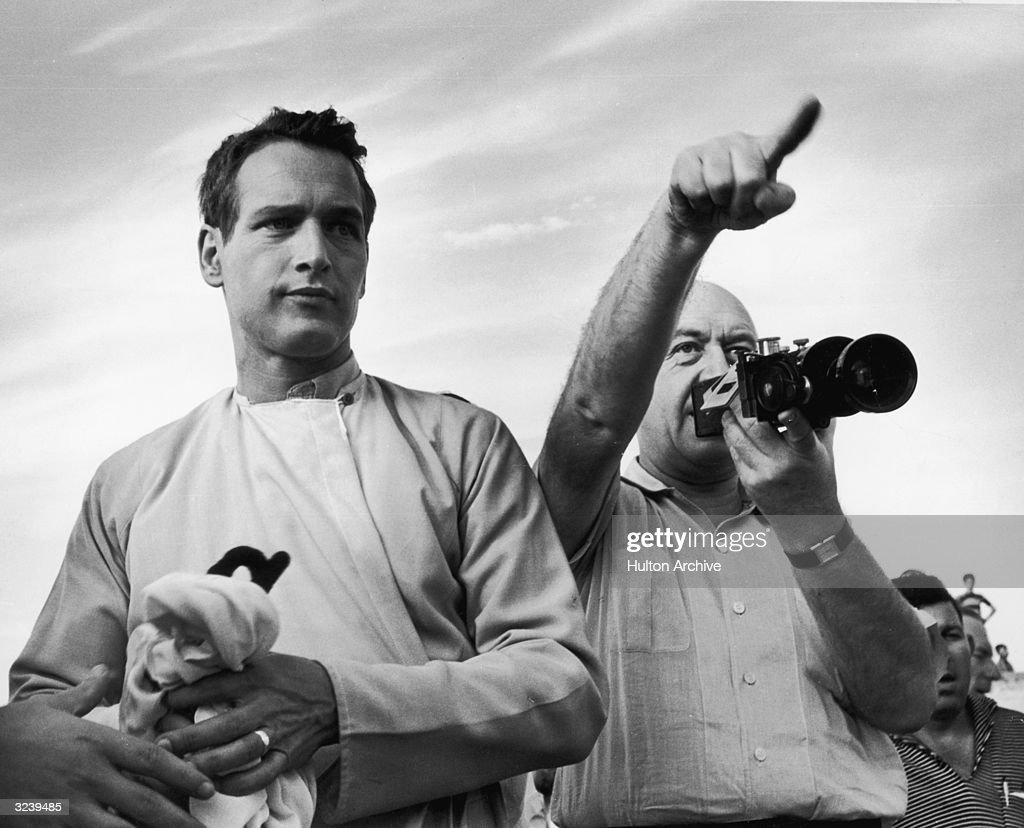 Austrian film producer and director Otto Preminger (1906 - 1986) with American actor Paul Newman on the set of the film 'Exodus,' in which Newman starred.