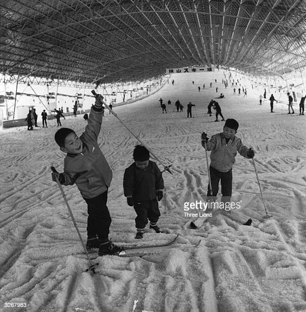 Children play on an undercover artificial ski slope