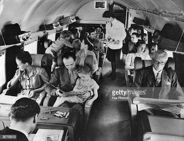 Interior of a BEA Vickers showing the passenger section the stewardess is about to serve lunch