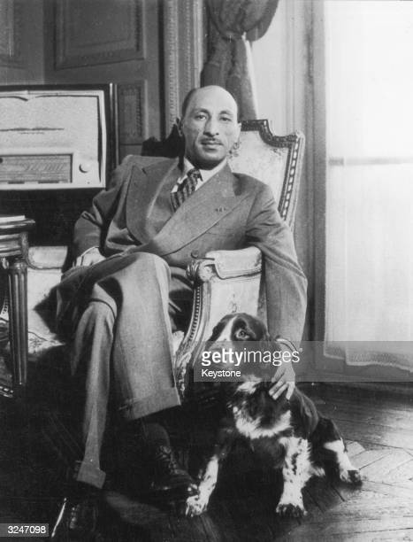King Mohamed Zaher Shah of Afghanistan relaxing with his dog
