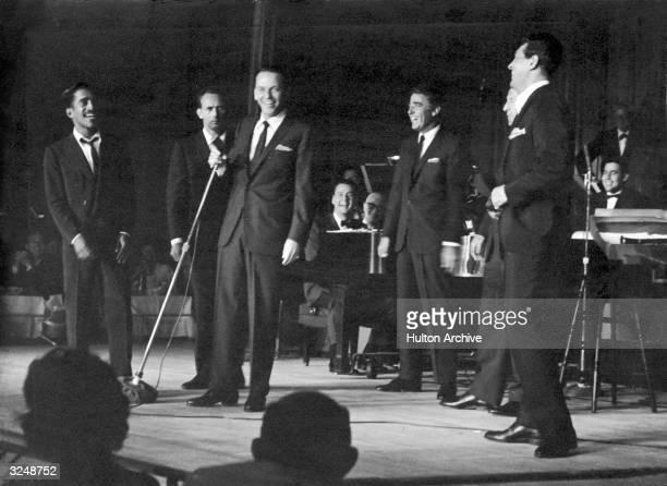 Members of the 'Rat Pack' perform on stage Las Vegas Nevada LR Sammy Davis Jr Joey Bishop Frank Sinatra Peter Lawford an unidentified man and Dean...