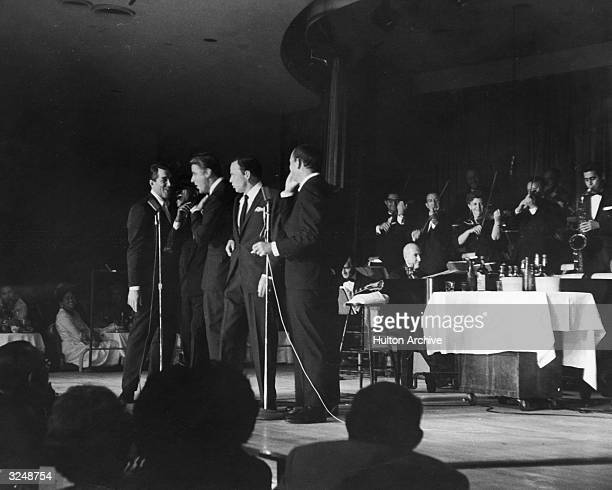 Members of the 'Rat Pack' perform on stage Sammy Davis Jr Joey Bishop Frank Sinatra Peter Lawford an unidentified man and Dean Martin Las Vegas Nevada