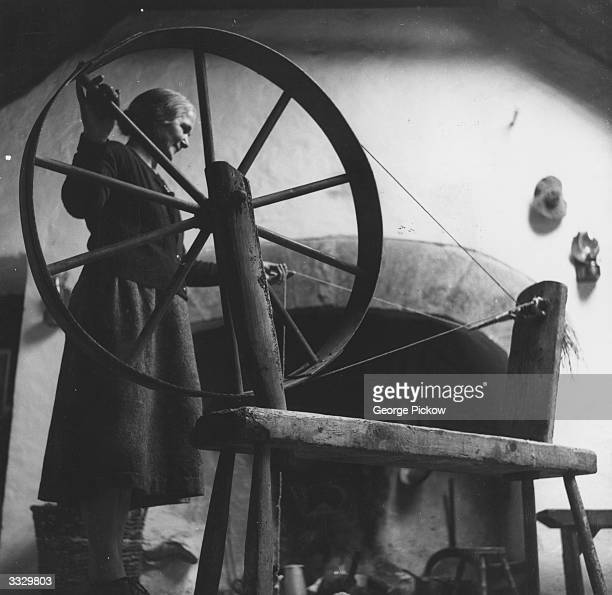Mrs Bartley Hernon twists the threads of spun wool in preparation for a long winter of knitting at Kilmurvy on Inishmore one of the Aran Islands off...