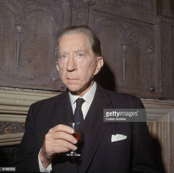 Oil multimillionaire and art collector J Paul Getty with a glass of wine