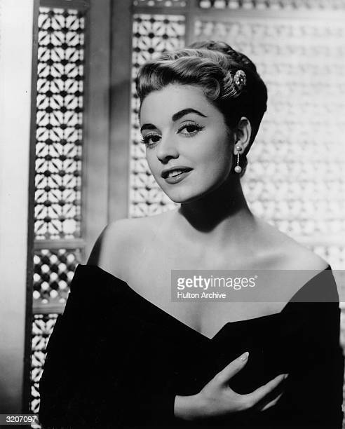 Portrait of Italianborn actor Anna Maria Alberghetti wearing an offtheshoulder black gown and holding one hand in front of her chest