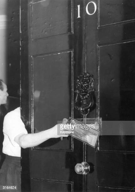 Replacing the letterbox of the famous doorway to the residence of the English Prime Minister at 10 Downing Street London
