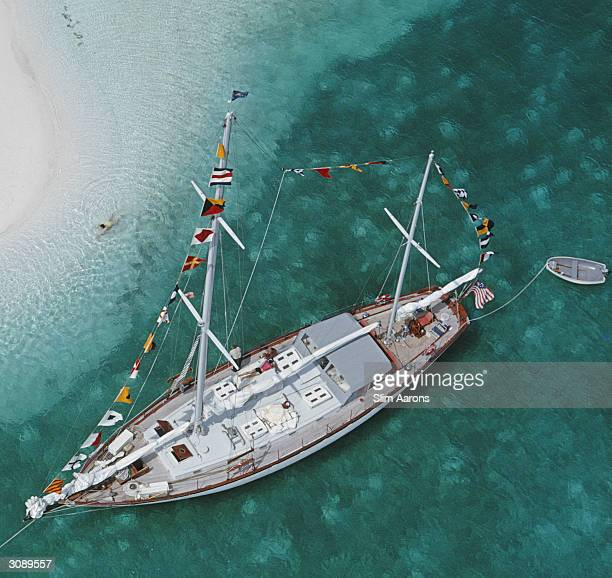Sixty eight foot charter ketch 'Traveller II' at anchor in the lee of Stocking Island across the harbour from George Town Exuma A Wonderful Time Slim...