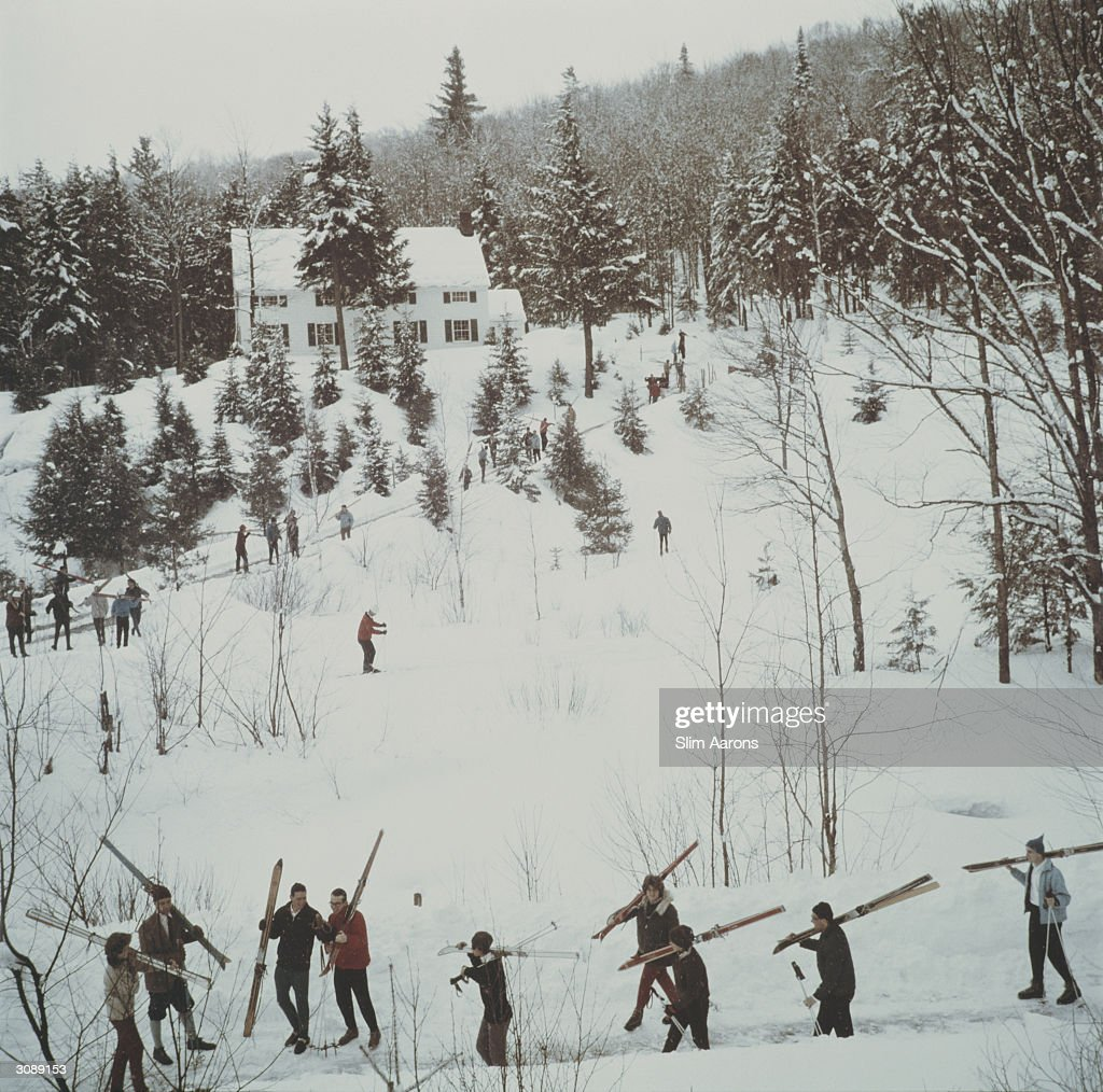 Students from Stowe Preparatory School track through deep snow near Mount Mansfield and Spruce Peak, Vermont. A Wonderful Time - Slim Aarons