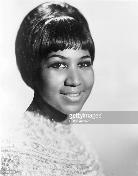 Studio portrait of American singer Aretha Franklin wearing a beaded top