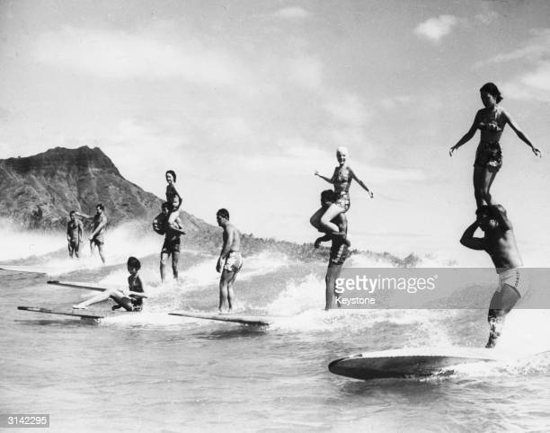 Surfers performing stunts in Hawaii