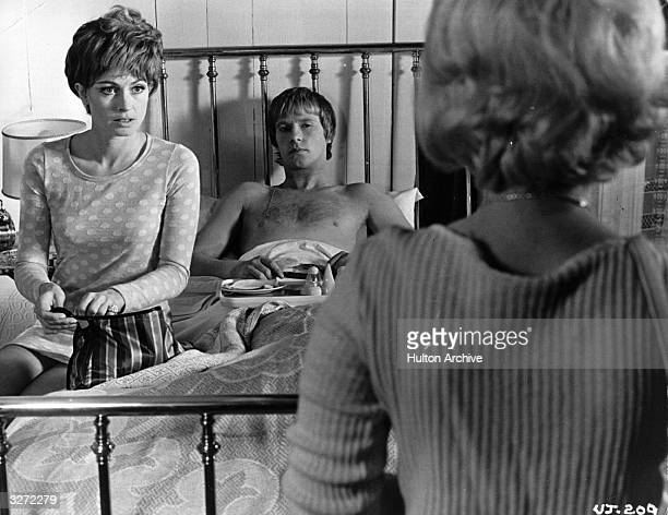 Suzy Kendal and Dennis Waterman star in 'Up the Junction' a Paramount film in a bedroom scene