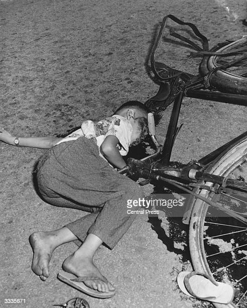 The body of an elevenyearold boy lying in a pool of his own blood beside his bicycle He was knocked down and murdered by members of a secret society...