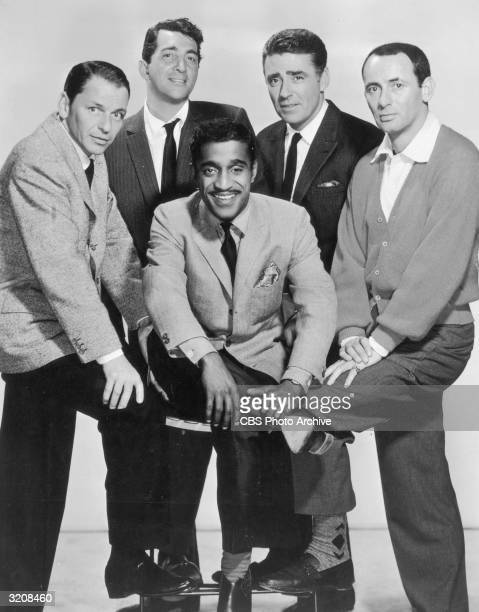 The members of the Rat Pack posing in a fulllength studio portrait LR Frank Sinatra Dean Martin Sammy Davis Jr Peter Lawford and Joey Bishop