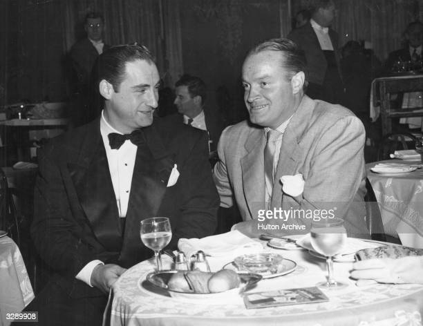 Comedians and actors Sid Caesar and Bob Hope dining in the Wedgwood Room of the Walfdorf-Astoria Hotel in New York City.