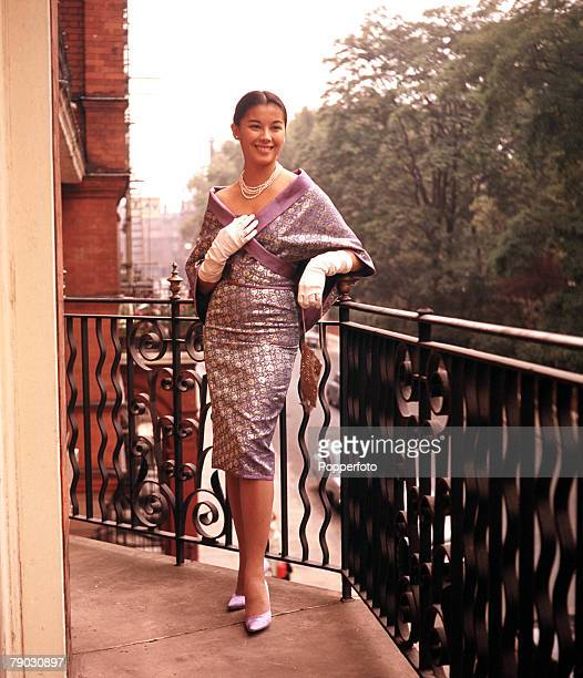 Circa 1960s A picture of the Eurasian actress France Nuyen modeling an attractive cocktail dress and cape in her London apartment